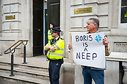 On the day the five week suspension of British Parliament begins, a pro remain campaigner holds a placard reading Boris is a neep a neep is Scottish slang for mashed turnips, outside the Cabinet Office in London, United Kingdom on 10th September 2019.