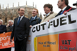 © licensed to London News Pictures. London, UK 07/03/2012. Quentin Wilson talks to members of  the FairFuel protest group hold a banner as they lobby outside the Houses of the Parliaments after handing in their report to Downing Street. Photo credit: Tolga Akmen/LNP