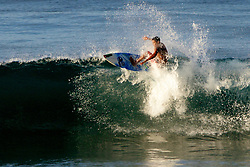 Surfer Surfing On Top Of Wave