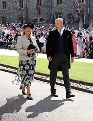 Sir Clive Woodward and Jayne Woodward arrive at St George's Chapel at Windsor Castle for the wedding of Meghan Markle and Prince Harry.
