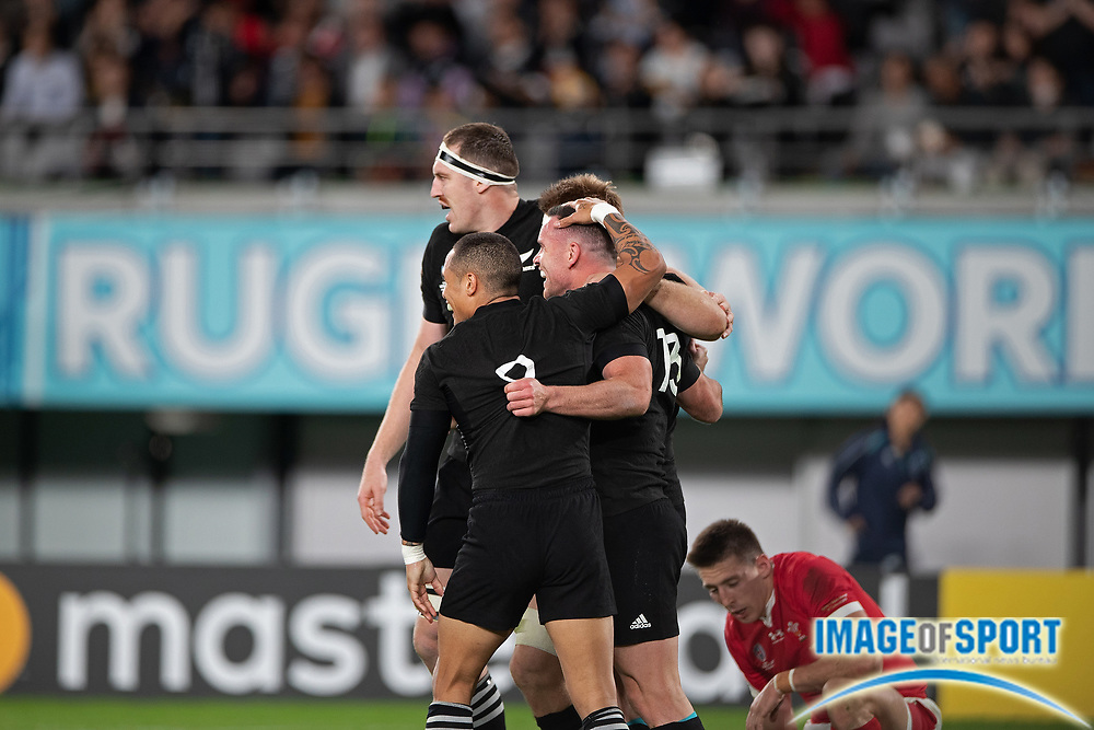 Ryan Crotty of New Zealand celebrates his try with his teammates during the Rugby World Cup bronze final match between New Zealand and Wales,  Friday, Nov, 1, 2019, in Tokyo. New Zealand defeated Wales 40-17. ( Flor Tan Jun/Espa-Images-Image of Sport)