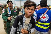 16 JUNE 2014 - POIPET, CAMBODIA: Cambodian migrants arrive in Poipet, Cambodia after returning to Cambodia from Thailand. More than 150,000 Cambodian migrant workers and their families have left Thailand since June 12. The exodus started when rumors circulated in the Cambodian migrant community that the Thai junta was going to crack down on undocumented workers. About 40,000 Cambodians were expected to return to Cambodia today. The mass exodus has stressed resources on both sides of the Thai/Cambodian border. The Cambodian town of Poipet has been over run with returning migrants. On the Thai side, in Aranyaprathet, the bus and train station has been flooded with Cambodians taking all of their possessions back to Cambodia.  PHOTO BY JACK KURTZ