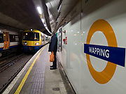 Wapping overground train station in East London, UK. Wapping is a district in East London, England, in the London Borough of Tower Hamlets.
