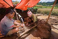 """Wet-seiving station outside Liang Bua, discovery site of the Flores """"hobbit"""", Homo floresiensis."""