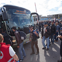 Illegal migrants traveling to Germany board a bus near Hegyeshalom (about 180 km West of capital city Budapest), Hungary on September 06, 2015. ATTILA VOLGYI