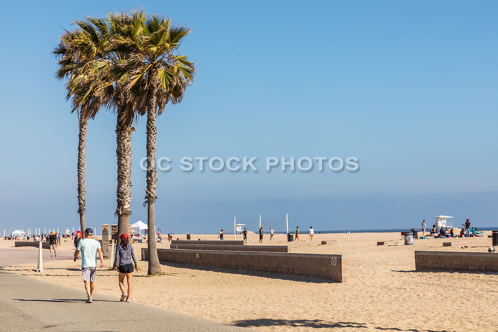 People Exercising On The Boardwalk in Huntington Beach