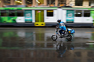 A food delivery rider is seen speeding through Swanston Street in the wet during COVID-19 in Melbourne, Australia. Victoria has recorded 14 COVID related deaths including a 20 year old, marking the youngest to die from Coronavirus in Australia, and an additional 372 new cases overnight. (Photo by Dave Hewison/Speed Media)