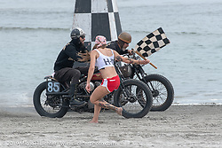 Sara Francello drops the flag at the starting line for Sushi (Atsushi Yasui) of Japan and Brian Charles (85) on their Harley-Davidson Knuckleheads at TROG (The Race Of Gentlemen). Wildwood, NJ. USA. Saturday June 9, 2018. Photography ©2018 Michael Lichter.
