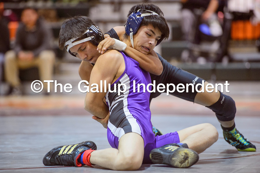 Miyamura Patriot Koby Baca grapples with Whitehorse Raider Ronnie Rico Wednesday at Wingate High School.