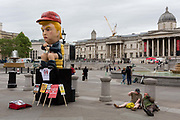 On US President Donald Trumps second day of a controversial three-day state visit to the UK, a Trump effigy tweets while sitting on a golden toilet before protesters voice their opposition to the 45th American President, in Trafalgar Square, on 4th June 2019, in London England.