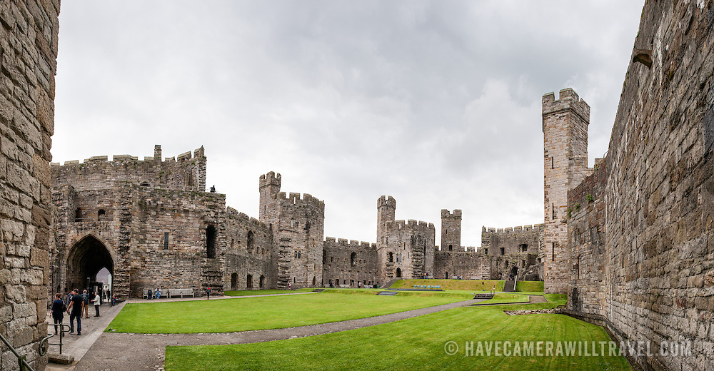 A panorama from inside the walls at Caernarfon Castle in northwest Wales. A castle originally stood on the site dating back to the late 11th century, but in the late 13th century King Edward I commissioned a new structure that stands to this day. It has distinctive towers and is one of the best preserved of the series of castles Edward I commissioned.