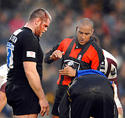 Wycombe. GREAT BRITAIN, Peter BRACKEN REceives attention for a cut head, referee David ROSE, watches, during the, Guinness Premiership game between, London Wasps and Leicester Tigers on 25/11/2006, played at  Adams<br />  Park,<br />  ENGLAND. Photo, Peter Spurrier/Intersport-images]