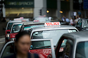 HONG KONG - MAY 06: A line of taxi cabs wait for clients in Central business district, on May 6, in Hong Kong. (Photo by Lucas Schifres/Pictobank)