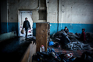 Migrants are seen in one of the warehouses where they found shelter in Belgrade, Serbia. 17th January 2017. Federico Scoppa