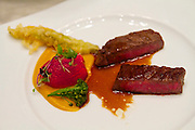 """Singapore. Marina Bay Sands. Sky on 57 showcases a modern twist of Franco Asian Cuisine in a setting that offers a birds eye view of Singapore and the bay..M7 Wagyu Beef """"Kobe cuisine"""".Glazed with Asian pepper sauce and summer vegetables"""