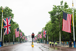 London, UK. 4 June, 2019. US and British flags fly alongside the Mall in front of Buckingham Palace on the occasion of a state visit by US President Donald Trump.
