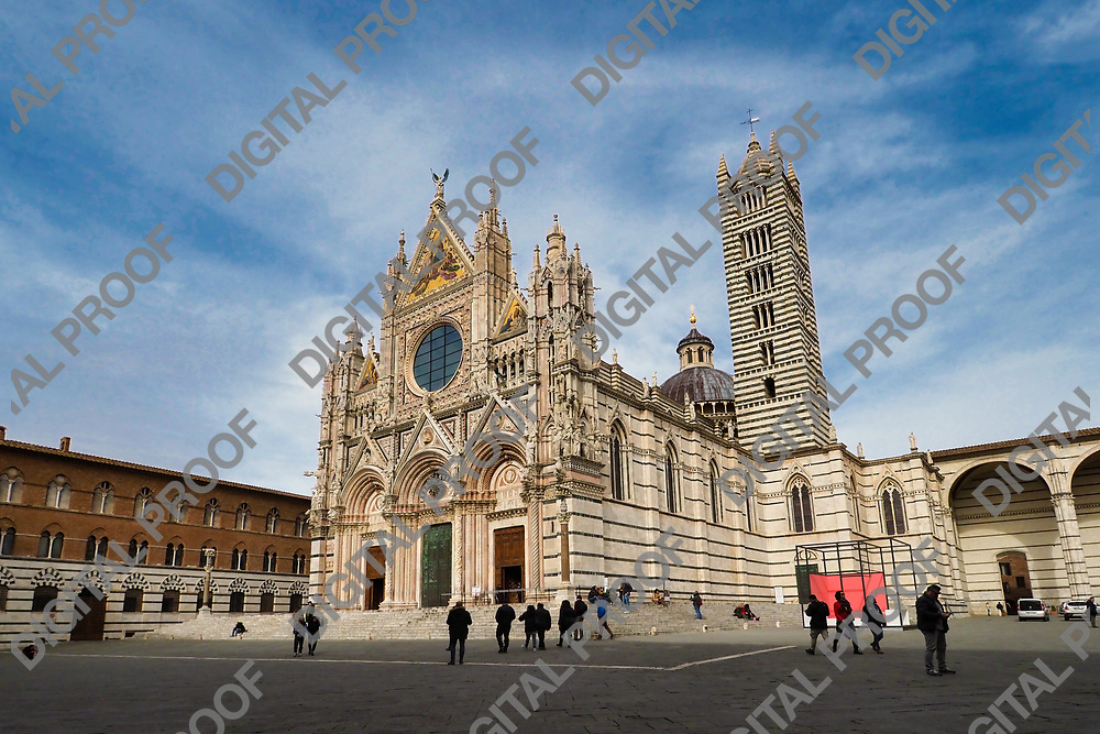 Side view of Siena Duomo with few visitors during the day
