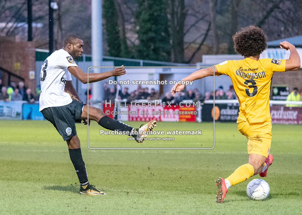 DOVER, UK - DECEMBER 29: Joe Widdowson of Leyton Orient tries to block a shot from Bedsente Gomis of Dover Athletic during the Vanarama National League match between Dover Athletic and Leyton Orient at the Crabble Stadium on December 29, 2018 in Dover, UK. (Photo by Jon Hilliger)