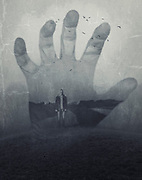 Double exposure of a hand and a landscape with a man