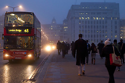 © Licensed to London News Pictures. 22/01/2013. London, UK. As Britain braces itself for more cold weather commuters make their way across London Bridge in heavy fog today (22/01/13). Photo credit: Matt Cetti-Roberts/LNP