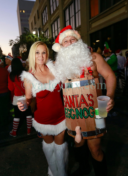 13 December 2014. New Orleans, Louisiana. <br /> The 4th annual running of the Santas in downtown New Orleans. Proceeds from the event benefit 'That Others May Love' charity.<br /> Photo; Charlie Varley/varleypix.com