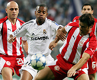 Real Madrid's Robinho in duel with Olympiakos' Kostoulas during their Champions League match at Santiago Bernabeu Stadium in Madrid, Wednesday 28 September, 2005. (Photo / Alvaro Hernandez)<br /> <br /> Photo Graffiti