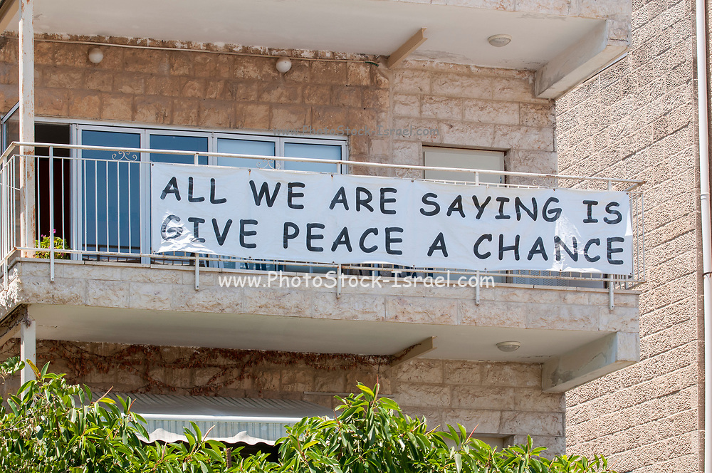 """'All we are saying is give peace a chance' This sign hangs from a balcony in front of the official residence of the Israeli President Reuven """"Ruvi"""" Rivlin in Jerusalem, Israel"""