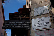 """Abandoned Herbalist Shop, Rethymno, Crete owned, apparently, by Panajiotis and or Dimitrios Kontogianis. The sign reads """"Ladies and Gentlemen welcome to Rethymno, city of love,  democratic peaceful and hospitable city"""""""