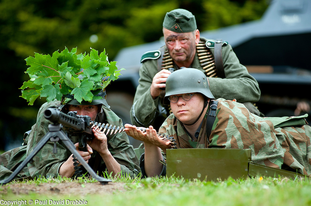 Reenactors portray a three man MG42 machine gun crew from the Panzer Grenadier Division GrossDeutschland at the Northallerton Wartime Weekend<br /> 18th and 19th June  2011<br /> Images © Paul David Drabble
