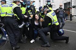 © Licensed to London News Pictures. 19/12/2020. London, UK.  Protorsters are arrested by police officers for taking part in an Anti Covid-19 lockdown demonstration in Central London. The group against the current tier regulations and vaccination for the Covid-19 disease. Photo credit: Ray Tang/LNP