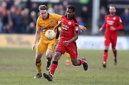 Lewis Young  of Crawley Town ® goes past Ryan Bird of Newport county.  EFL Skybet football league two match, Newport county v Crawley Town at Rodney Parade in Newport, South Wales on Saturday 1st April 2017.<br /> pic by Andrew Orchard, Andrew Orchard sports photography.