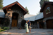 Incline Village, Nevada - August 21, 2020: Lauren Rossmann, left, and Brett Rossman, right, pose for a portrait in front of their future home on August 21, 2020 in Incline Village, Nevada. Wealthy residents of expensive urban areas on the West Coast who can now work from home, particularly tech workers in the Bay Area, are fueling real estate booms in smaller resort towns in the North Lake Tahoe region.<br />CREDIT: Salgu Wissmath for The Wall Street Journal<br />Slug: TAHOEBOOM