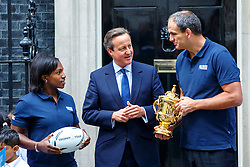 © Licensed to London News Pictures. 17/09/2015. London, UK. Prime Minister David Cameron welcoming the Webb Ellis Cup to Number 10 Downing Street as Martin Johnson, England's Rugby World Cup 2003 winning Captain, and Maggie Alphonsi, part of the England Women's team who won the  World Cup in 2014 bring the cup to the street on the day before the start of the Rugby World Cup on Thursday, 17 September 2015. Photo credit: Tolga Akmen/LNP
