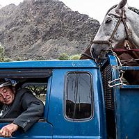 Horse handler and his horses, Kyrgyzstan, 2018.