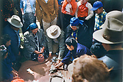 CS00378-06. A game of chance entertains at the Feast of the First Salmon, Celilo Indian village, April 24, 1955.