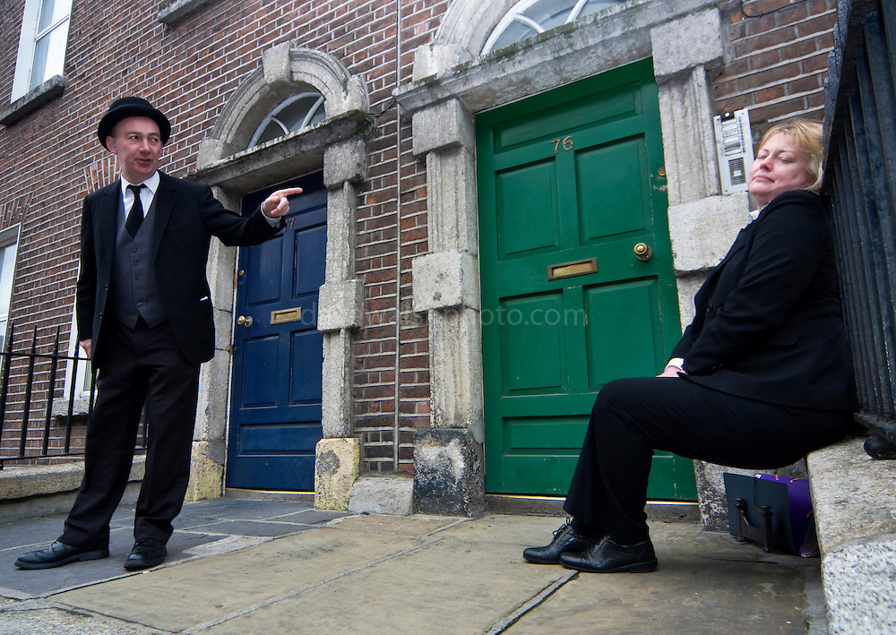"""Editorial Use Only. Bloomsday June  16th 2008, Dublin. Actor Paul O'Hanrahan from Balloonatics theatre company performs the """"Calypso"""" chapter from  James Joyce novel Ulysses around Eccles St. and Dorset Street. Molly Blook sleeps on."""