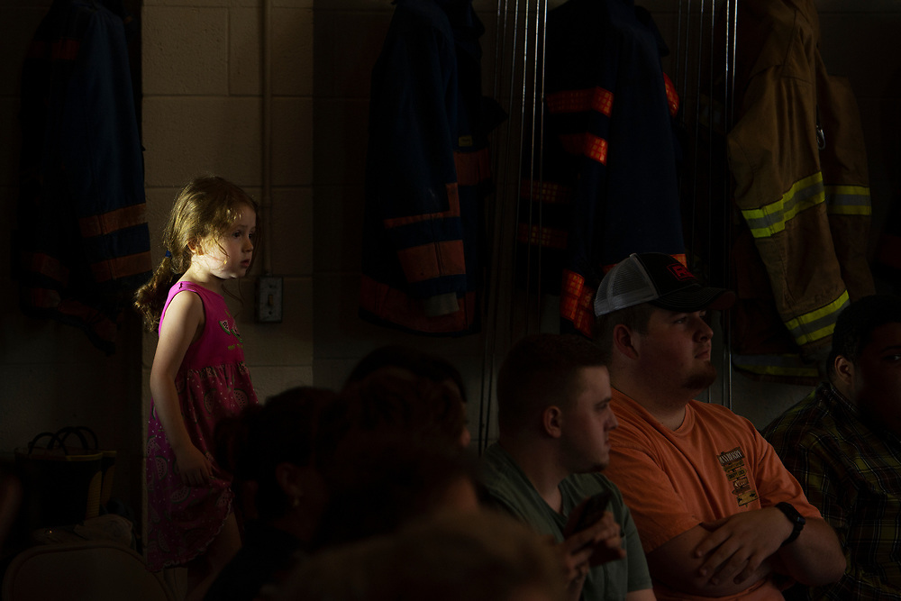 """Julia Frankenberry, 4, of Charleston, waits for 2020 Democratic presidential candidate Sen. Elizabeth Warren, D-Mass., to arrive for a """"community conversation"""" event at the Kermit Fire & Rescue Headquarters Station, Friday, May 10, 2019, in Kermit, W.Va."""