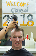 West Point, New York - A new cadet gets his military haircut during Reception Day at the United States Military Academy at West Point on July 2, 2014. About 1,200 cadet candidates, the West Point Class of 2018, reported to the academy to begin their military careers.