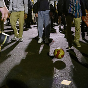 Protesters kick a soccer ball around while they wait for the results of the presidential election at Black Lives Matter Plaza in Washington DC, November 3, 2020.