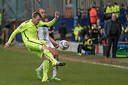 Andy Wright (Southport) clears the ball while Tranmere manager Gary Brabin (Tranmere Rovers) watches onduring the Vanarama National League match between Tranmere Rovers and Southport at Prenton Park, Birkenhead, England on 6 February 2016. Photo by Mark P Doherty.