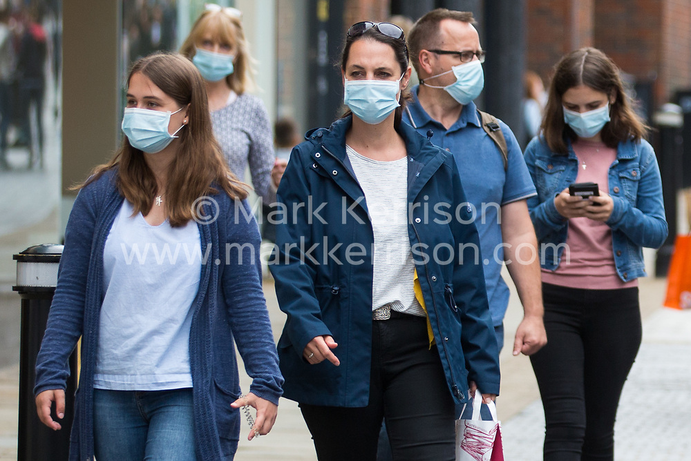 Windsor, UK. 27th August, 2020. Shoppers wear face coverings in Peascod Street. Tessa Lindfield, the Director of Public Health for Berkshire, has urged residents of the Royal Borough of Windsor and Maidenhead to follow social distancing guidelines following a significant rise in the number of positive COVID-19 tests there over the past week.