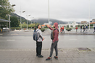 In downtown Bergen, Nader (left) explains to Omar (right) how to take the bus back home, and the general layout of the city on Omar's first morning in the country.