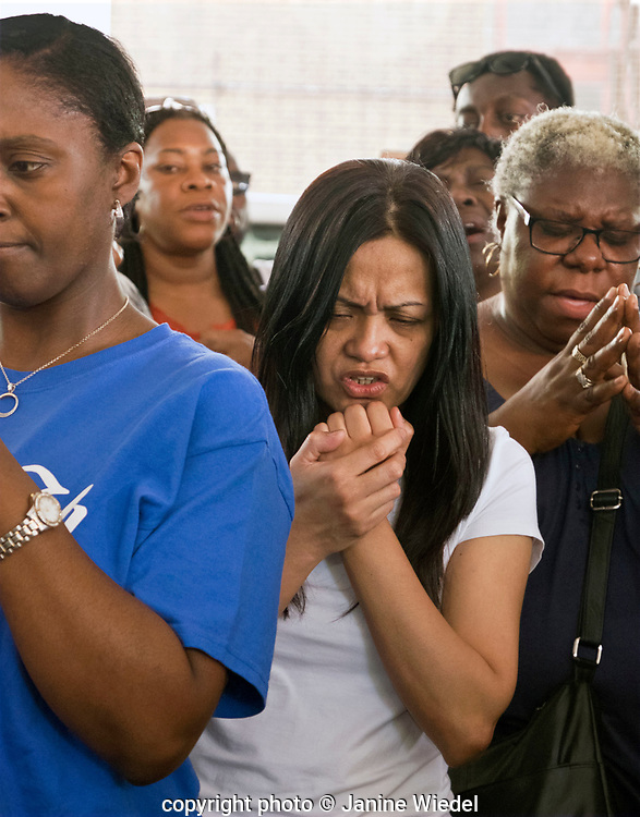 The family and friends of those missing and dead in  the fire that destroyed the 24-story Grenfell Tower in North Kensington, London on 14th June 2017.  The death toll officially at 75 but will no doubt rise to three figures.