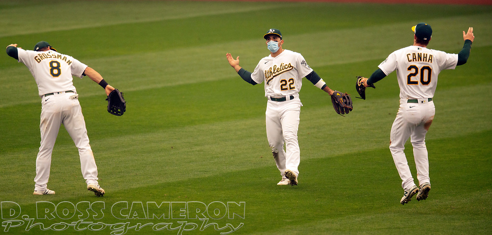 Sep 10, 2020; Oakland, California, USA; Oakland Athletics outfielders Robbie Grossman (8), Ramon Laureano (22) and Mark Canha celebrate following the final out of the ninth inning of a baseball game against the Houston Astros at Oakland Coliseum. Mandatory Credit: D. Ross Cameron-USA TODAY Sports