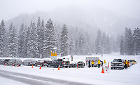 Teton County Search and Rescue personnel prepare gather at the Coal Creek trailhead Thursday morning to begin looking for a missing snowboarder who was buried in an avalanche on Taylor Mountain the day before. Several agencies and more than two dozen people were involved in the search.