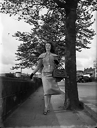 """Sunday Express Special - Miss Aideen O'Kelly, Abbey Actress<br /> 04/10/1956<br /> <br /> Aideen O'Kelly (05/09/1940) Was born in Dalkey, County Dublin. She is an Irish actress of stage and television, who works in both Ireland and the United States.<br /> <br /> She appeared on Broadway in New York in Othello (as Emilia) and in Philadelphia Here I Come! (as Lizzy Sweeney). She has also appeared in numerous Irish Repertory Theatre productions in NYC.<br /> <br /> She appeared off-Broadway on several occasions, most notably in Samuel Beckett's Happy Days as """"Winnie"""". She earned the following 1987 review from Mel Gussow of the New York Times for this role:<br /> <br /> """"Aideen O'Kelly conforms more than many of her predecessors to the physical outline suggested by the author: blond, plump and bosomy. At the outset, the actress has an amiable, almost chipper quality as she goes through Winnie's ritual ablutions and her marital memories. But when she is called upon to laugh, the laughter is forced...[A]s in all of Beckett, the power is in the ambiguities, and Ms. O'Kelly is less ambiguous than she should be. She only begins to capture the eloquence of the play...[S]he is, however, engaging, and she is indisputably Irish. Before coming to America, Ms. O'Kelly was a member of the Abbey Theatre. Her director, Siobhan O'Casey, herself an actress and a designer, is the daughter of Sean O'Casey. In her production, which represents her directorial debut, one is aware of the Irish lilt of Beckett's language.""""<br /> <br /> She has appeared on American television in Third Watch and Law & Order."""