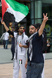 "© Licensed to London News Pictures . 12/07/2014 . Manchester , UK . Thousands of people outside the BBC at Media City in Salford , Greater Manchester , this afternoon (Saturday 12th July 2014) , protesting Israeli actions in Gaza and the Corporation's coverage of the Israeli Palestinian conflict . A convey branded "" Drive for Justice "" travelled from out of the city from Bradford , Blackburn and other regions , to form the protest . Photo credit : Joel Goodman/LNP"