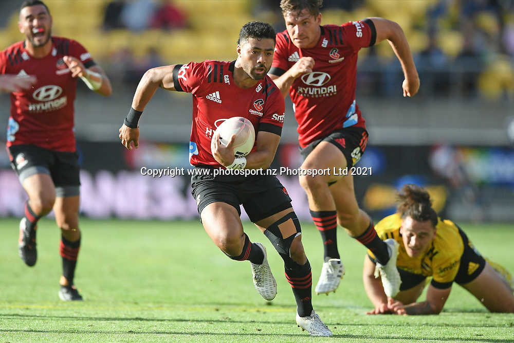 Crusaders Richie Mo'unga makes a break in the Super Rugby match, Hurricanes v Crusaders, Sky Stadium, Wellington, Sunday, April 11, 2021. Copyright photo: Kerry Marshall / www.photosport.nz