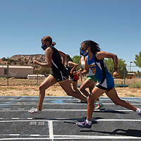 Brandy Ray, left, of Navajo Prep and Alexandria Bewanika of Zuni compete in the girls 3200 meter run Friday in Zuni.