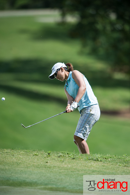 April 28 2012: Candie Kung hits a chip shot on to the green of the 10th hole during the third round of the Mobile Bay LPGA Classic at Magnolia Grove in Mobile, AL.